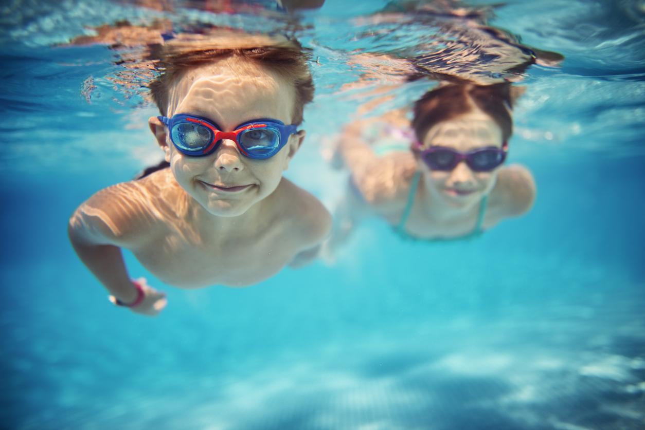 Smiling kids enjoying underwater swim in the pool in Woolacombe North Devon
