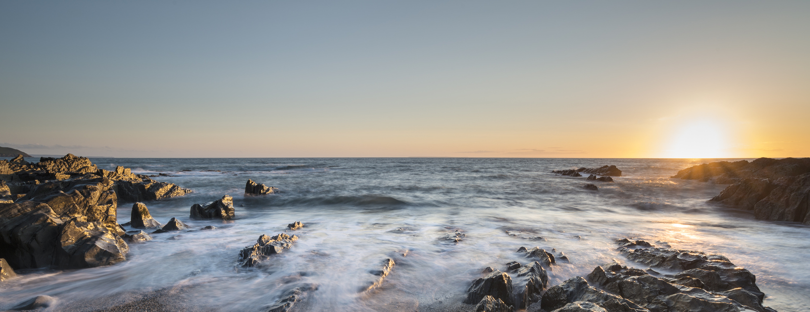 Panorama sunset landscape of Woolacombe beach in Devon England